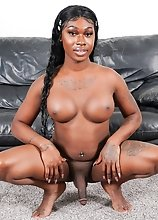 Black tgirl Rose loves showing off her juicy ass! She takes it to the shower, from here to the love seat where she strokes her cock till she cums!