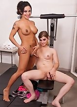 Adorable tgirls Foxxy and Tiffany having fun in gym