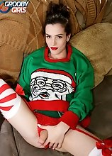 Carrie Emberlyn looks sexy in her Christmas sweater and she is eager to show it all! Watch her as she strips and strokes her cock until she cums!
