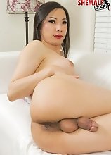 Gorgeous Bora Gin is a stunning Asian American tgirl with a hot smooth body, sexy boobs, a sexy bubble butt and a rock hard cock! See this horny Groob