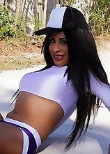 Sexy tranny in slutty clothes posing in a Mexican garden